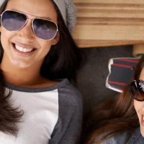 Two happy smooth-haired female friends with skates for the Smooth Hair tips and products page.