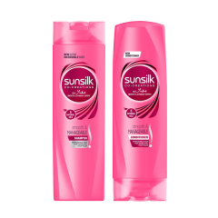 Three friends with frizzy, wavy hair blowing soap bubbles for Sunsilk's Homepage.